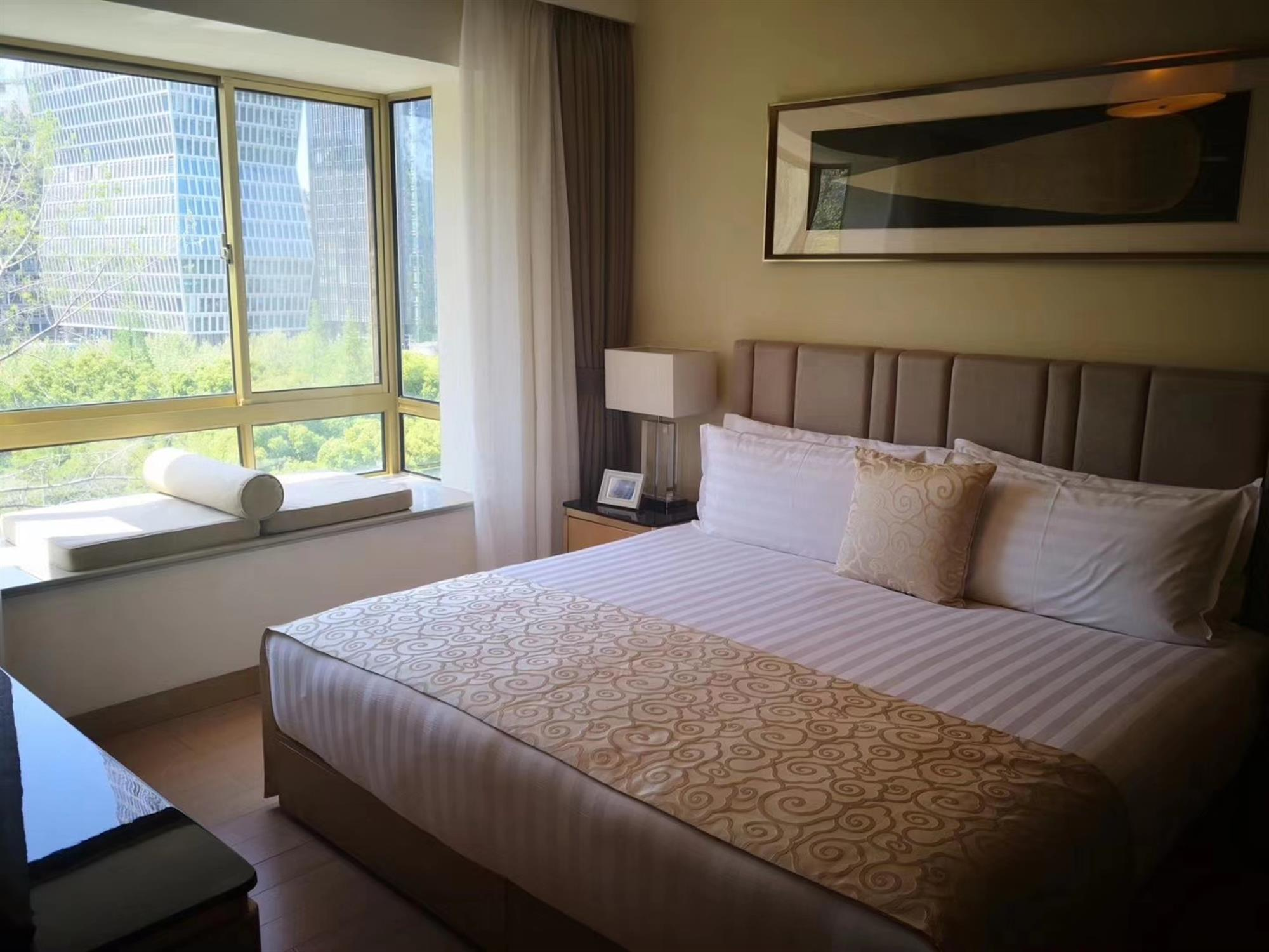 big bed High-End Gubei Service Apartments Available in Shanghai